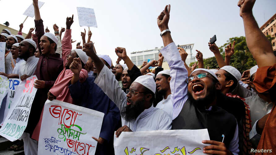 Bangladeshi Muslim activists gather in front of Baitul Muqarram National Mosque to protest against deaths of Rohingya Muslim in the Rakhine state of Myanmar, in Dhaka, Bangladesh, Dec. 1, 2016.