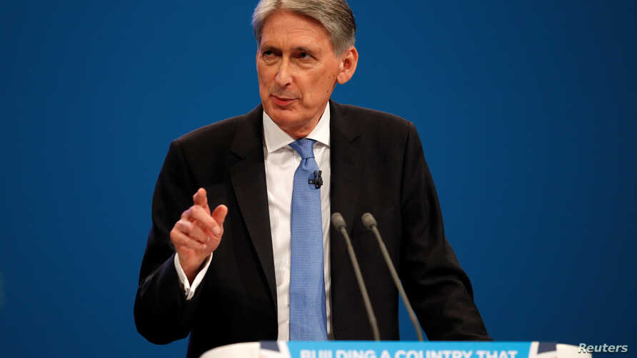 Britain's Chancellor of the Exchequer Philip Hammond speaks at the Conservative Party's conference in Manchester, Britain, Oct. 2, 2017.