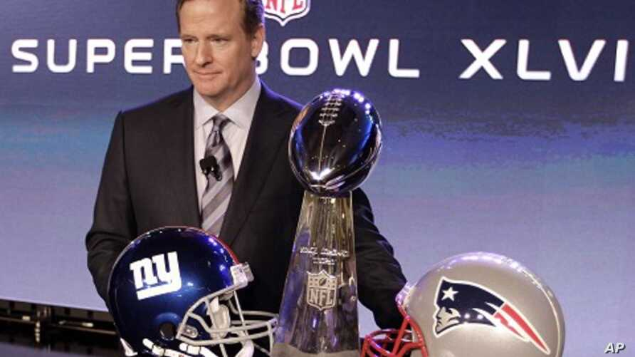 NFL Commissioner Roger Goodell poses with the Vince Lombardi Trophy after a news conference in Indianapolis, Feb. 3, 2012.
