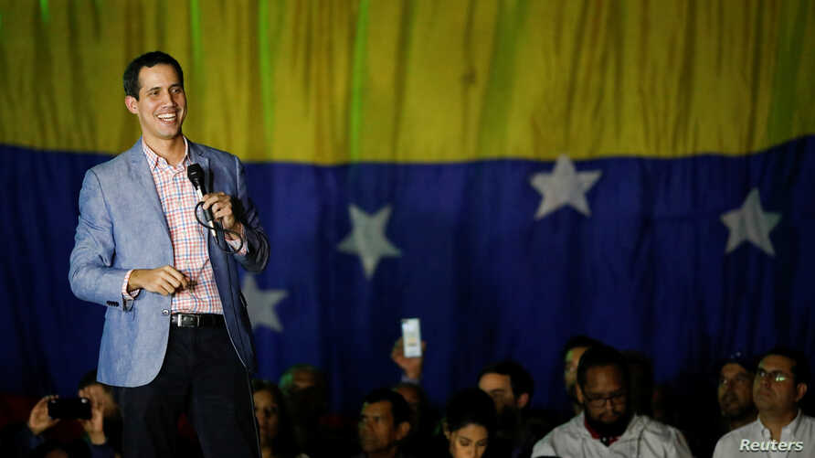 Juan Guaido, President of Venezuela's National Assembly, smiles as he speaks during a gathering in Caracas, Venezuela, Jan. 16, 2019.