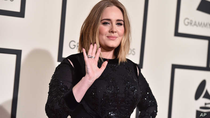 FILE - Adele arrives at the 58th annual Grammy Awards at the Staples Center on Feb. 15, 2016, in Los Angeles.