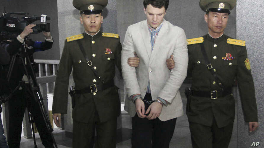 American student Otto Warmbier, center, is escorted at the Supreme Court in Pyongyang, North Korea, March 16, 2016. North Korea's highest court sentenced Warmbier to 15 years in prison after he allegedly attempted to steal a propaganda banner.