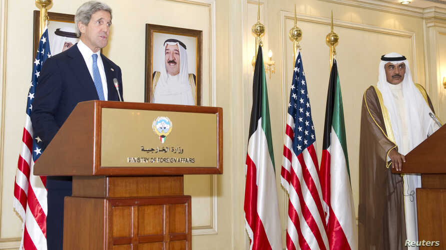 U.S. Secretary of State John Kerry (L) and Kuwait's Deputy Prime Minister and Minister of Foreign Affairs Sheikh Sabah Khalid Hamad al-Sabah speak to the media in Kuwait City, June 26, 2013.