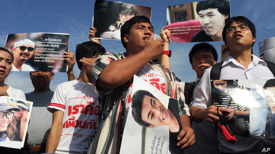 Supporters of 14 detained students protest outside the military court in Bangkok, Thailand, July 7, 2015.