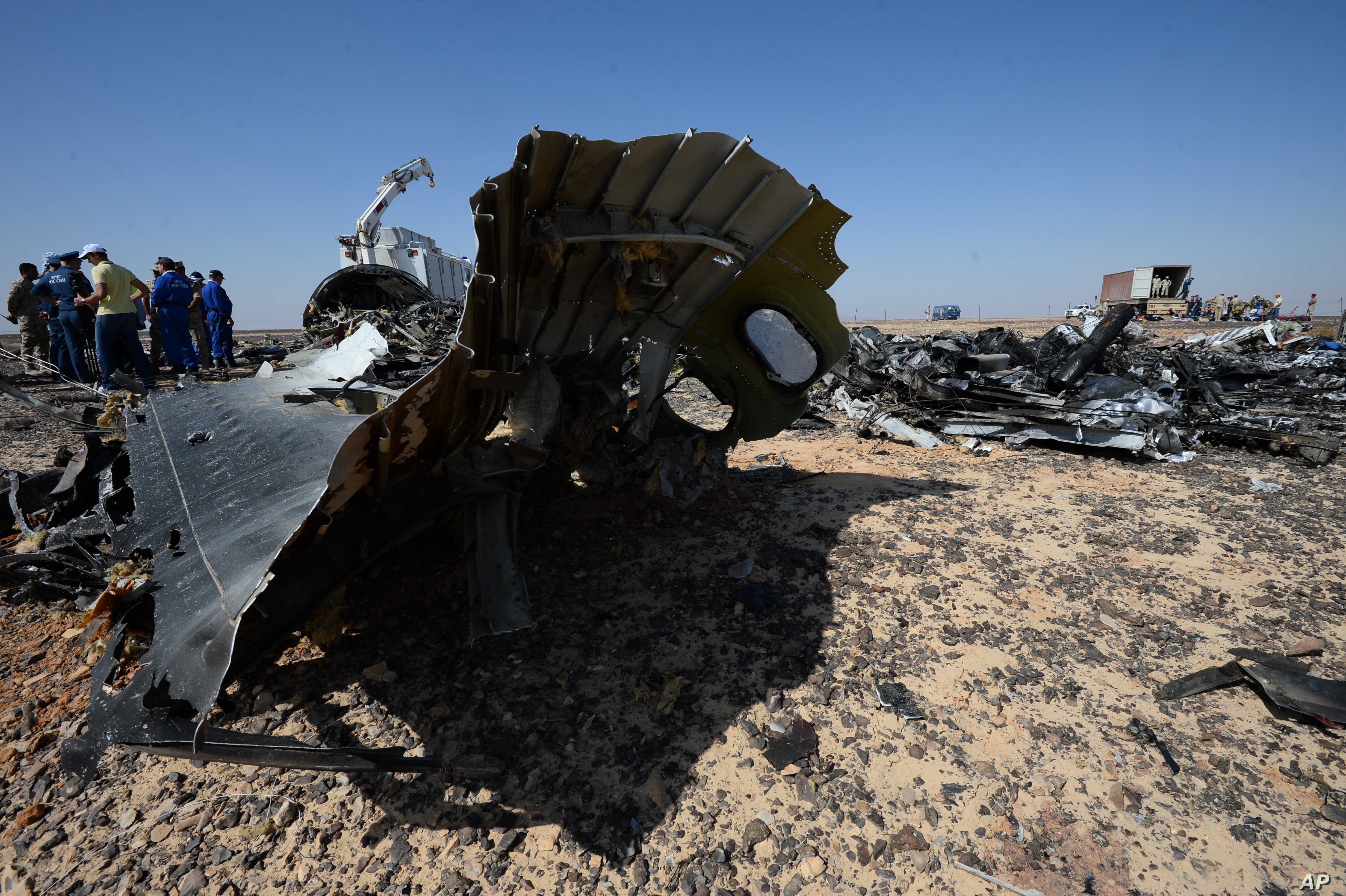In this Russian Emergency Situations Ministry photo, Russian Emergency Ministry experts work at the crash site of a Russian passenger plane bound for St. Petersburg in Russia that crashed Saturday in Hassana, Egypt's Sinai Peninsula, Nov. 2, 2015.