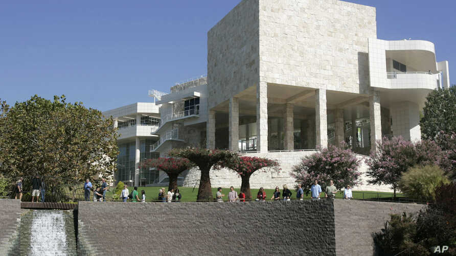 FILE - Visitors walk in the gardens at the J. Paul Getty Museum in Los Angeles,Oct. 9, 2005.
