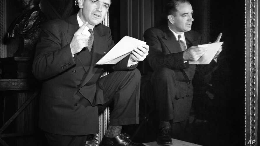 "Sen. Joseph McCarthy (R-Wisc.) poses in Washington, March 23, 1950 after he accused the president of endangering the nation's security by what he called the president's ""arrogant refusal"" to release loyalty files of State department employees accused"