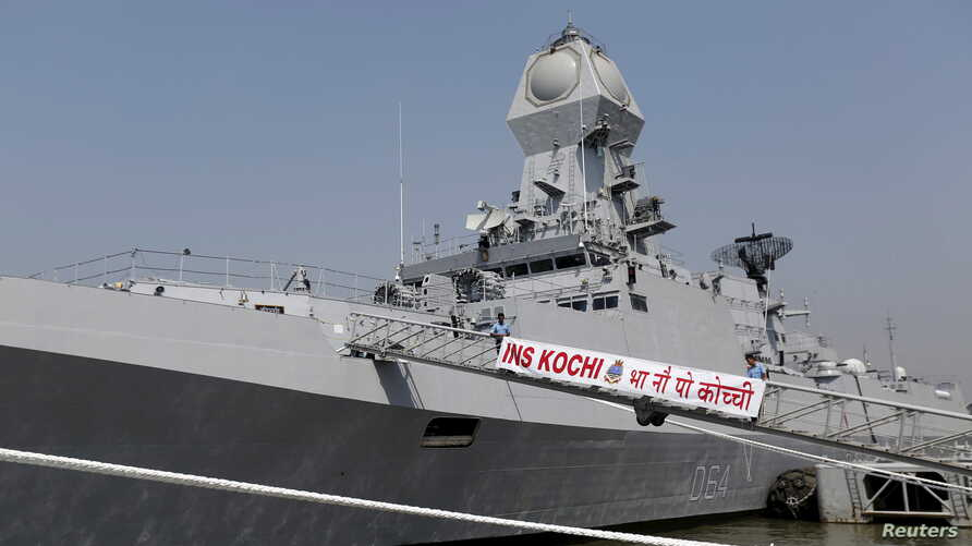 FILE - Indian Navy personnel board the newly built INS Kochi, a guided missile destroyer, during a media tour at the naval dockyard in Mumbai, Sept. 28, 2015.
