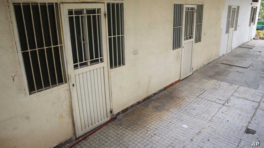 This April 7, 2016 photo shows barred rooms of the Chez Maurice Hotel in Maamelteine north of Beirut, Lebanon.  Lebanese security forces have busted a sex trafficking ring involving 75 Syrian women trafficked to Lebanon from their country and forced