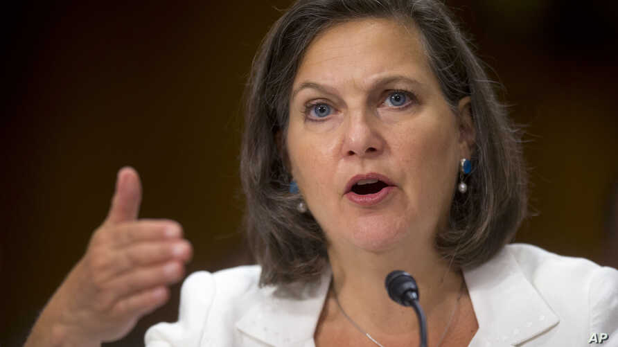 FILE - In this July 9, 2014 photo, Assistant Secretary of State Victoria Nuland testifies on Capitol Hill in Washington.
