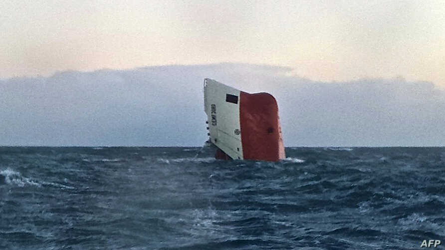 The upturned hull of the Cypriot-registered cargo vessel Cemfjord is shown in the North Sea 15 miles from Wick in northeast Scotland, Jan. 3, 2015.