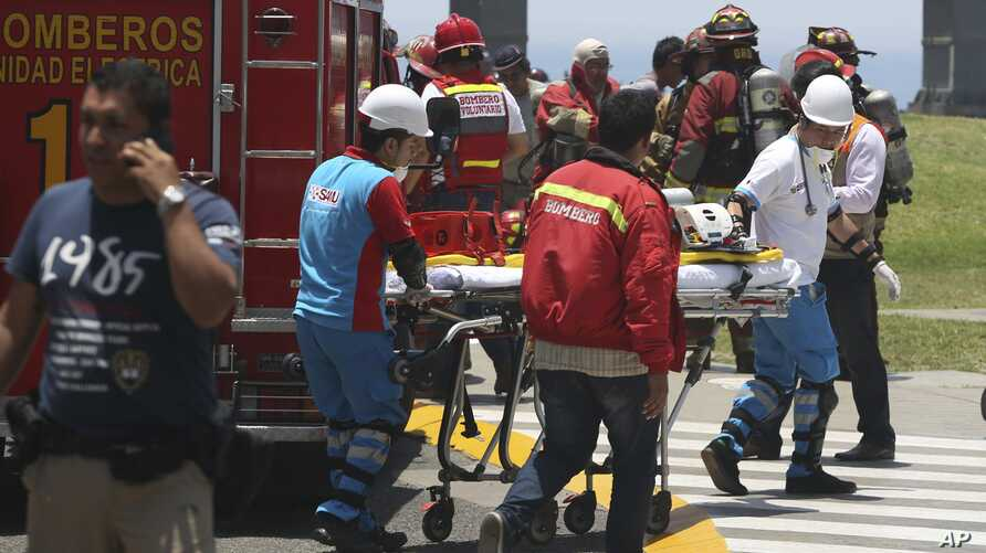 Peru Deadly Fire: Firefighters prepare a stretcher outside Larcomar's shopping mall during a deadly fire in Lima, Peru, Wednesday, Nov. 16, 2016.