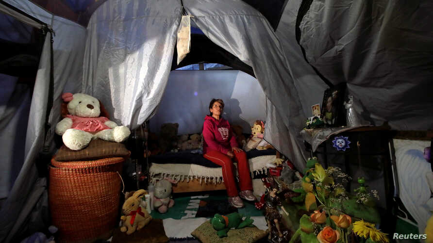 Maria Guadalupe Padilla rests in her tent in the Tlalpan neighbourhood, near the site where her building was damaged by the devastating earthquake, that took place in Mexico City last year, Mexico, Sept. 7, 2018.