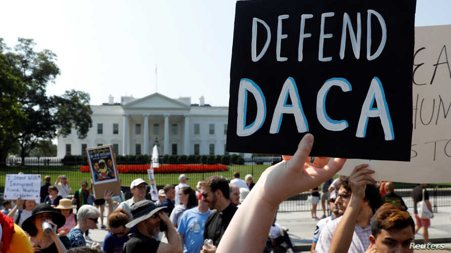 FILE _ Demonstrators protest in front of the White House after the Trump administration today scrapped the Deferred Action for Childhood Arrivals (DACA), Sept. 5, 2017.
