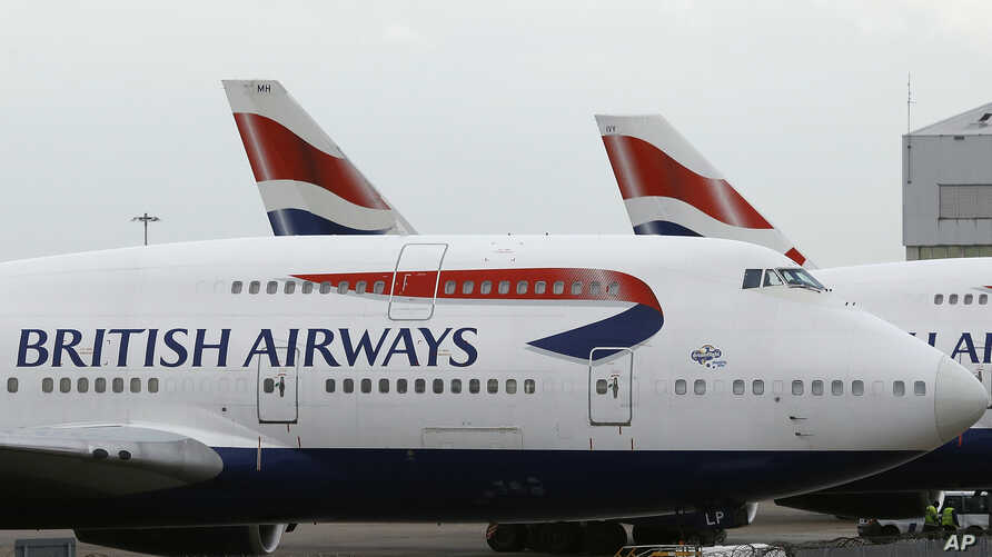 FILE - British Airways planes are parked at Heathrow Airport in London, Britain, Jan. 10, 2017.