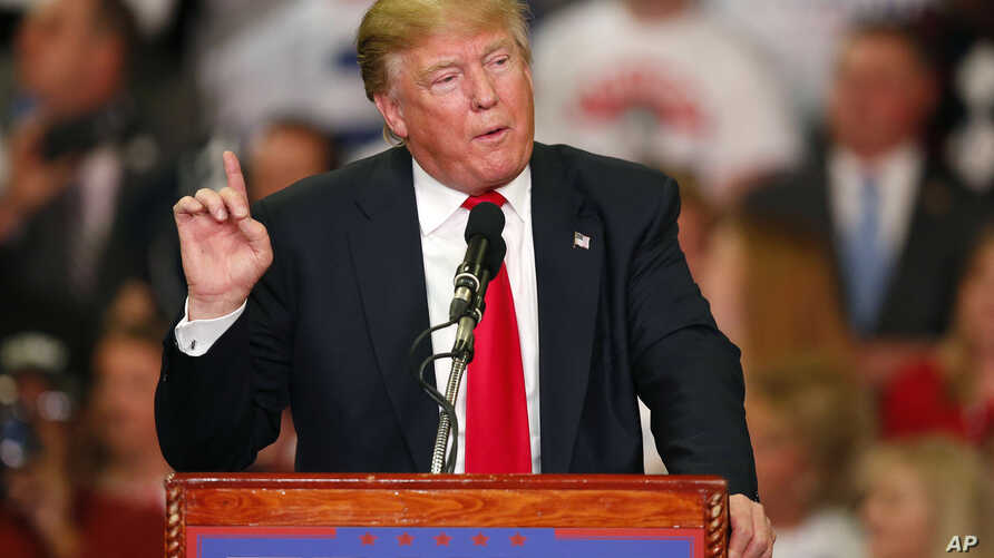 Republican presidential candidate Donald Trump speaks during a campaign rally in Madison, Miss., March 7, 2016.