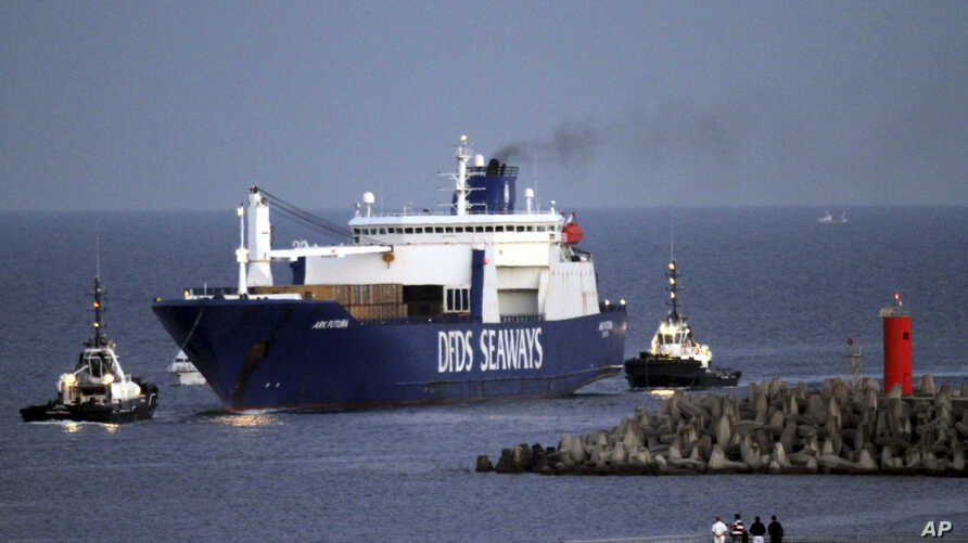 FILE - The Danish cargo ship Ark Futura, carrying 1,300 tons of Syrian chemical weapons to be destroyed, arrives at Gioia Tauro port, southern Italy, July 2, 2014.