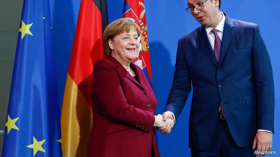 German Chancellor Angela Merkel and Serbian Prime Minister Aleksandar Vucic shake hands before their talks at the Chancellery in Berlin, Germany, March 14, 2017.