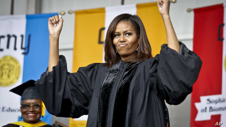 FILE - First lady Michelle Obama reacts to cheers from the class of 2016, during commencement for City College of New York, Friday June 3, 2016.