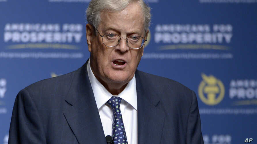 FILE - Americans for Prosperity Foundation Chairman David Koch speaks in Orlando, Fla., Aug. 30, 2013. David Koch and his brother Charles plan to spend millions to promote the recently signed tax overhaul.