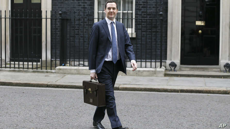 FILE - Britain's Chancellor George Osborne walks across Downing Street on his way to attend a press conference at the Foreign Office with Christine Lagarde of the International Monetary Fund, in London, May 13, 2016.
