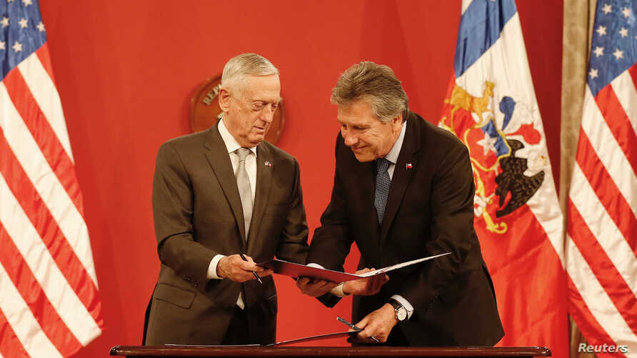 U.S. Defense Minister James N. Mattis, exchange agreements with Chilean Defence Minister Alberto Espina, during a meeting at La Moneda Presidential Palace in Santiago, Chile, Aug. 16, 2018.