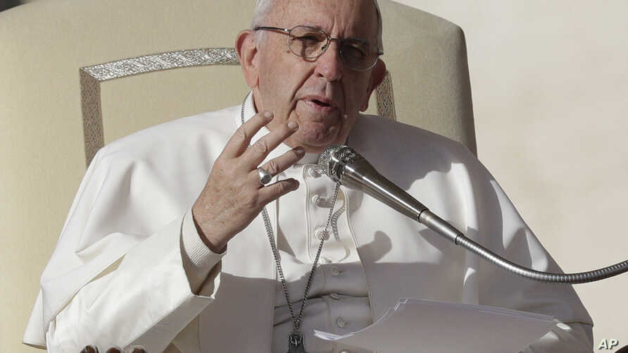 FILE - Pope Francis speaks during his weekly general audience in St. Peter square at the Vatican, Nov. 22, 2017. Pope Francis heads to Myanmar and Bangladesh.