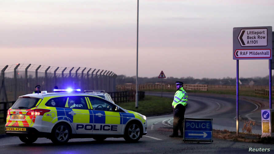 British police stand guard at the entrance to the U.S. Air Force base at RAF Mildenhall, Britain, Dec. 18, 2017.
