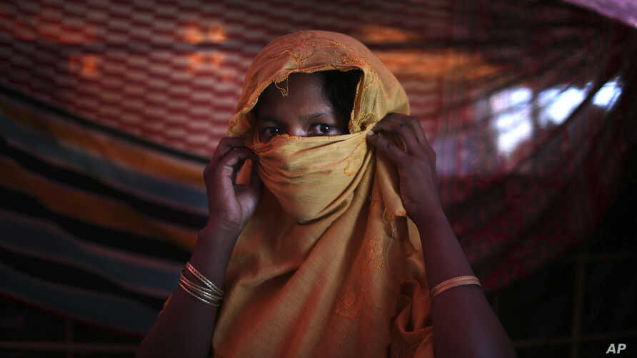 This 22-year-old mother of one, who did not want her name used, says she was raped by members of Myanmar's armed forces in late August. She is photographed in her tent in the Gundum refugee camp in Bangladesh, Nov. 23, 2017.