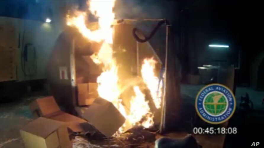 FILE - This file frame grab from video, provided by the Federal Aviation Administration (FAA) shows a test at the FAAs technical center in Atlantic City, N.J. last April, where a cargo container was packed with 5,000 rechargeable lithium-ion batterie