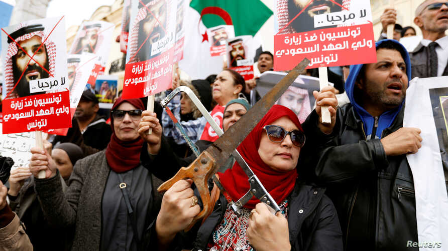 Tunisians take part in a protest, opposing the visit of Saudi Arabia's Crown Prince Mohammed bin Salman in Tunis, Tunisia, Nov. 27, 2018.