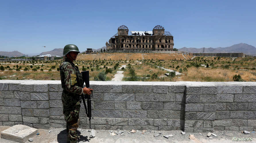 FILE - An Afghan National Army soldier stands guard after the inauguration of the reconstruction project to restore the ruins of historic Darul Aman palace, in Kabul, Afghanistan, May 30, 2016