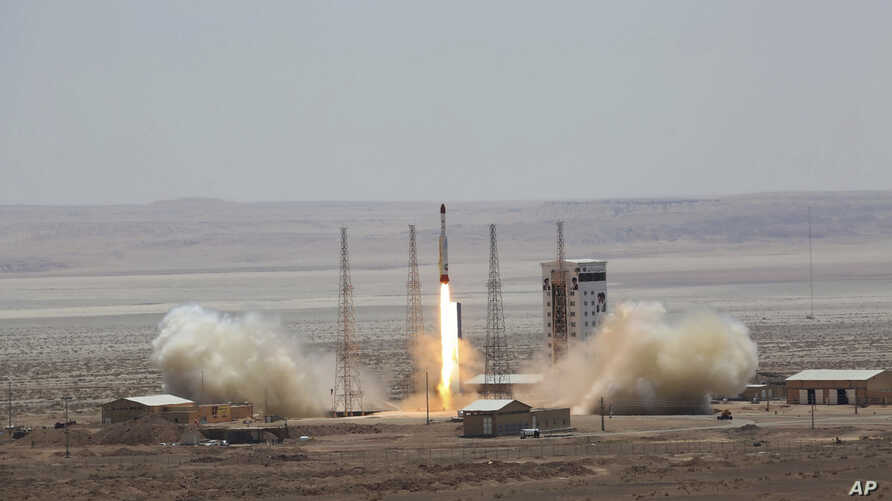 This photo, released by the official website of the Iranian Defense Ministry, July 27, 2017, claims to show the launching of Simorgh satellite-carrying rocket in an undisclosed location in Iran.