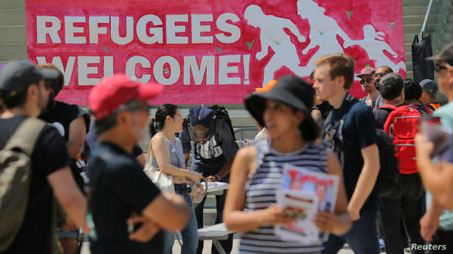People gather for an anti-racism rally in downtown Toronto, Aug. 11, 2018. Canada announced Wednesday plans to increase deportations of immigrants in the country illegally.