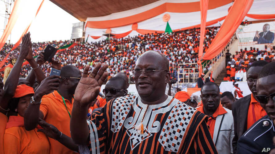 Burkina Faso presidential candidate Roch Marc Christian Kabore from the MPP party waves during a rally in Ouagadougou,  Burkina Faso, Nov. 27, 2015.