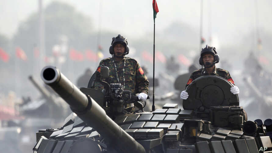 FILE - Myanmar military tanks are driven during a parade to commemorate the nation's 72nd Armed Forces Day in Naypyitaw, March 27, 2017.