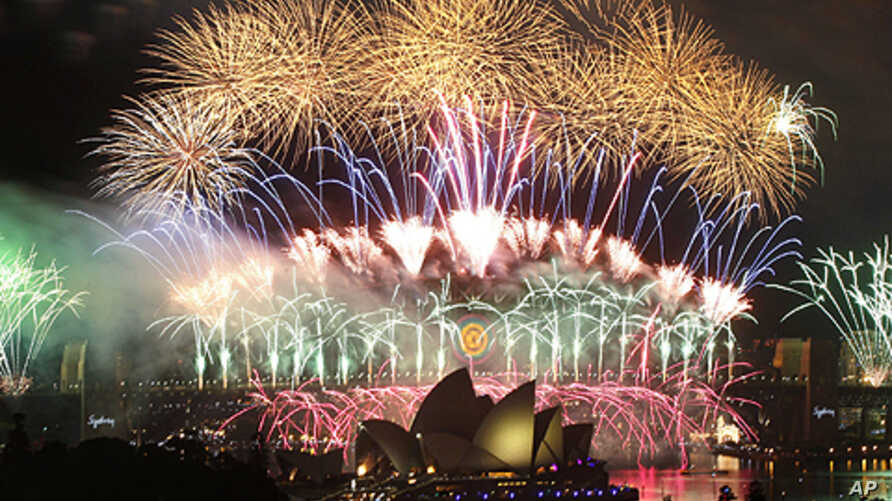 Fireworks explode over the Sydney Harbor Bridge and Opera House during a pyrotechnic show to celebrate the New Year, January 1, 2012.