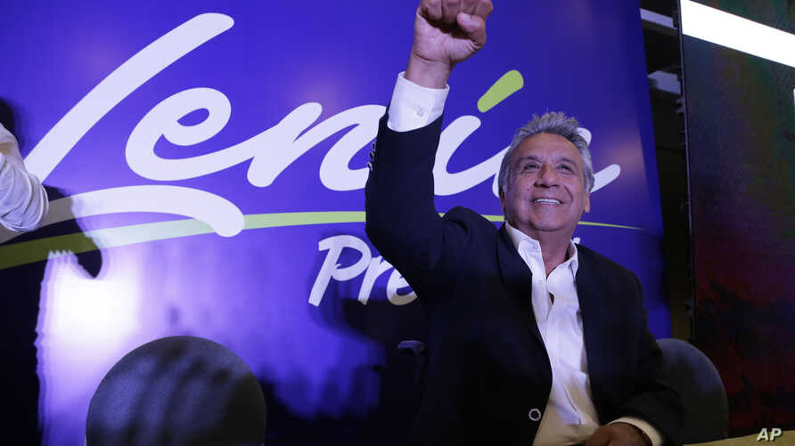 Lenin Moreno, presidential candidate for the ruling party Alliance PAIS, celebrates the closing of the polls for the general election, in Quito, Ecuador, Sunday, Feb. 19, 2017.