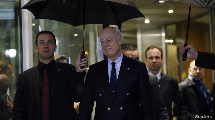 U.N. mediator for Syria Staffan de Mistura (R) arrives for a news conference on the Syrian peace talks outside President Wilson hotel in Geneva, Switzerland Feb. 3, 2016.