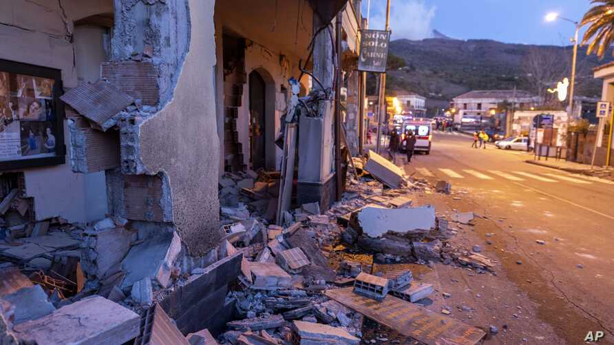 Debris from a partially collapsed house sits on a street in Fleri, Sicily Italy, Dec. 26, 2018.