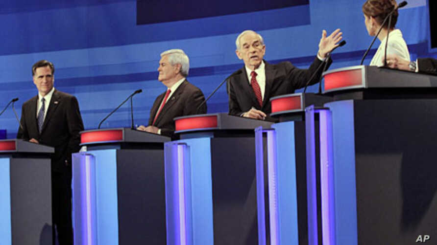 Republican presidential candidates (L-R) former Massachusetts Gov. Mitt Romney, former House Speaker Newt Gingrich, Rep. Ron Paul, and Rep. Michele Bachmann, participate in a Republican presidential debate in Sioux City, Iowa, December 15, 2011