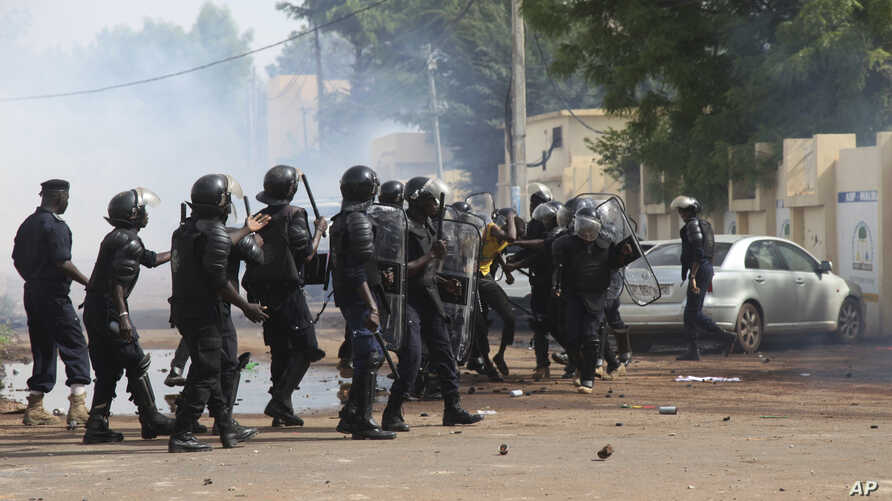FILE - Mali's riot security forces battle with opposition activists during a prohibited march in Bamako, Mali, June 2, 2018.