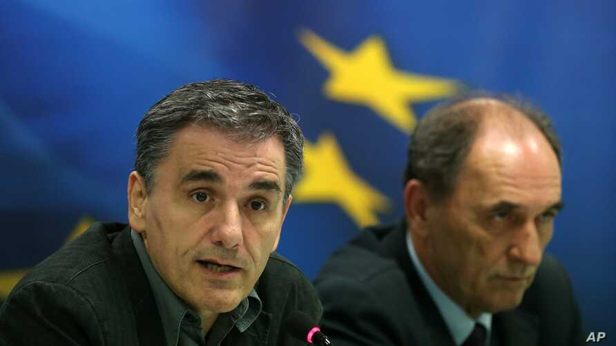 Greece's Finance Minister Euclid Tsakalotos, left, speaks during a news conference as Economy Minister Giorgos Sathakis listens, in Athens, Nov. 17, 2015.