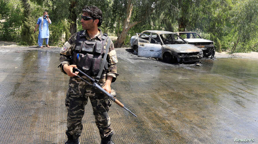 An Afghan security force stands guard at the site of a suicide attack in Jalalabad city, Afghanistan July 10, 2018.