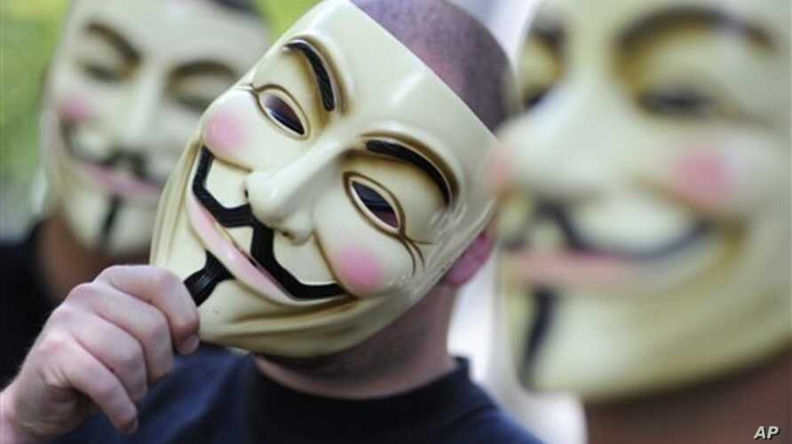 "Activists of the international network ""Anonymous"" behind their masks posing in Berlin."
