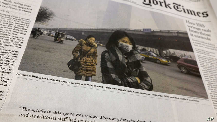 Front page of an Asian edition of the International New York Times has a blank space where the printer omitted sensitive content, Bangkok, Thailand, Dec. 1, 2015.