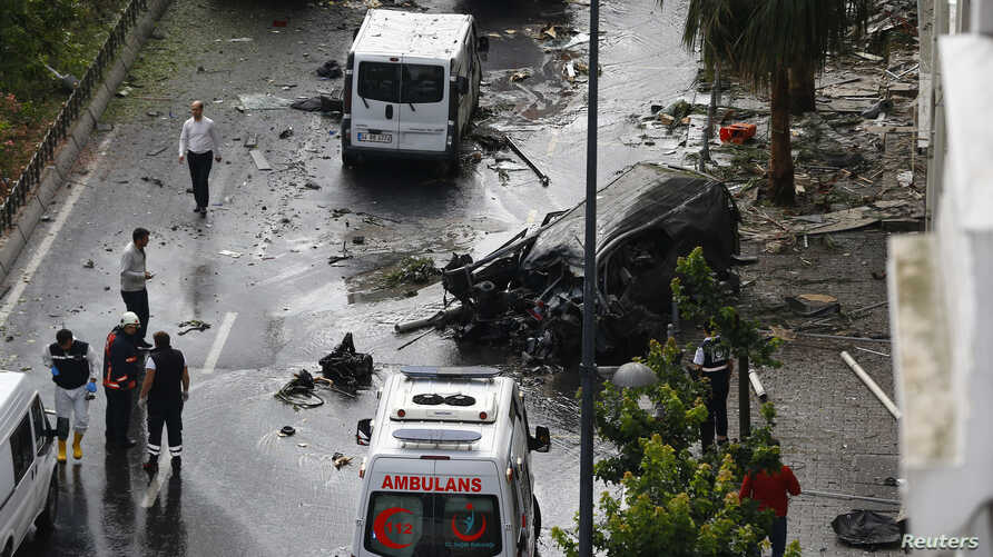 A destroyed van is pictured near a Turkish police bus which was targeted in a bomb attack in a central Istanbul district, Turkey, June 7, 2016.