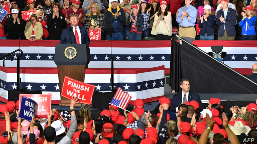 FILE - U.S. President Donald Trump speaks during a rally in El Paso, Texas, Feb. 11, 2019. The British Broadcasting Corporation has asked the White House for a review of security arrangements after a BBC cameraman was assaulted at the rally.