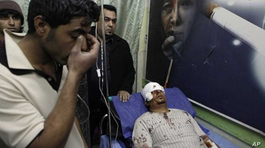 Mohammed Ali lies in a hospital bed after being injured in a car bomb attack in Zafaraniyah, Baghdad, Iraq,  Jan. 27, 2012.