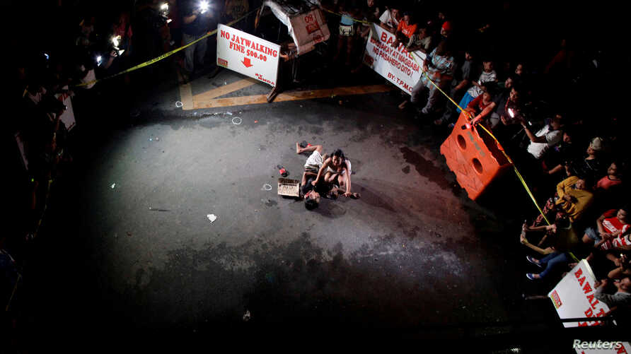 Jennelyn Olaires, 26, weeps over the body of her partner, who was killed on a street by a vigilante group, according to police, in a spate of drug related killings in Pasay city, Metro Manila, Philippines, July 23, 2016.